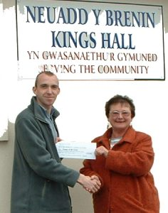 Sophia Drew (Chair PDEA) presenting Daniel Graham (Secretary F.O.S.A.C) with the cheque.